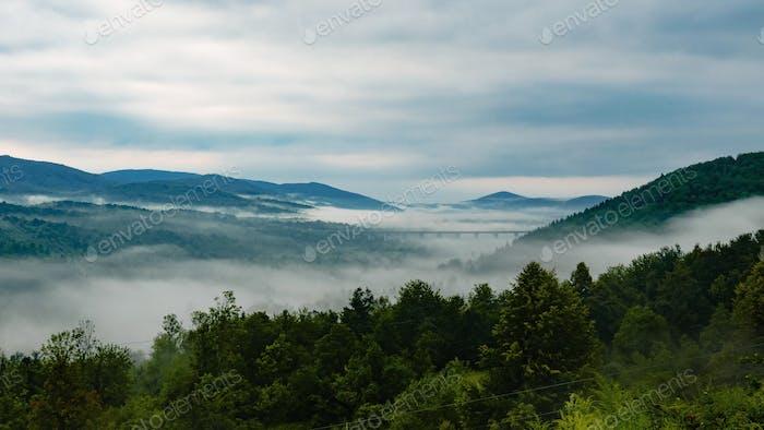 Foggy landscape, hills, moody sky, nature, background, mist.