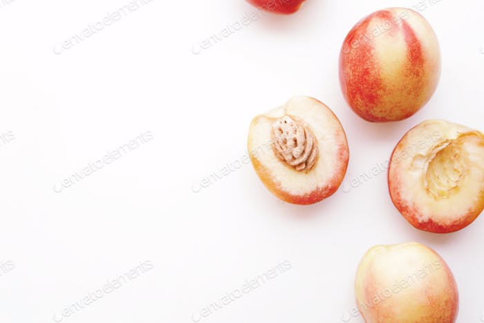 Nectarines on a white background