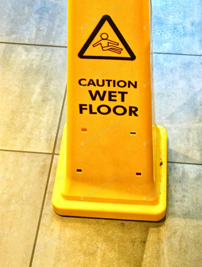 YELLOW MOBILE WARNING CONE : CAUTION WET SLIPPY FLOOR  CUSTOMER BE AWARE RISK OF SLIPPING OR FALLING