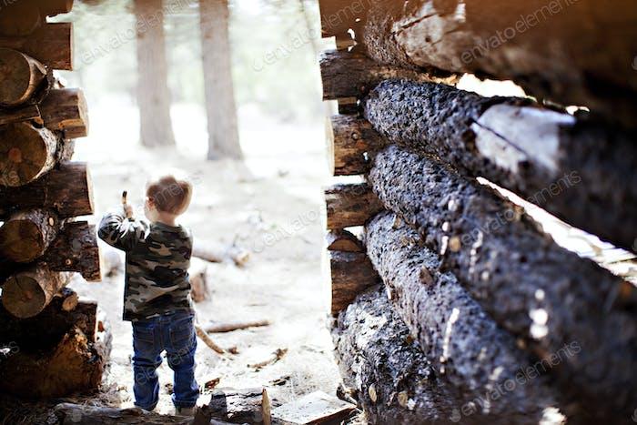 Lumberjack baby in a rustic wood log house