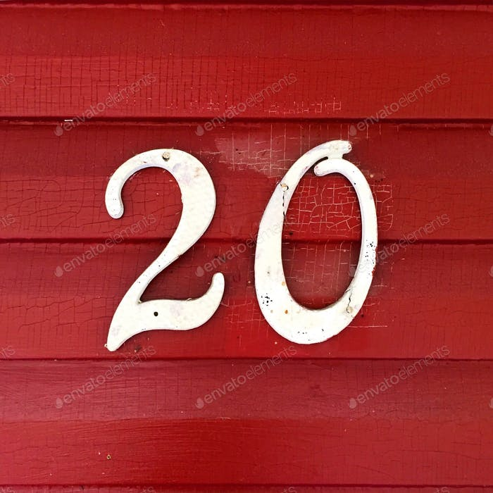 The number 20 on distressed crimson home siding