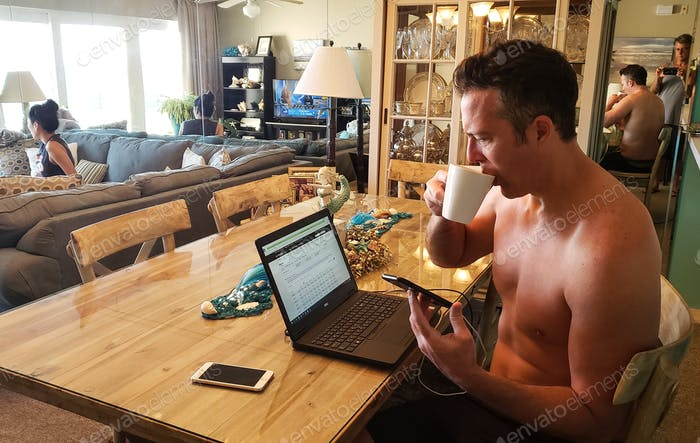 Generation X businessman on vacation checking up on his work to not fall behind before packing up