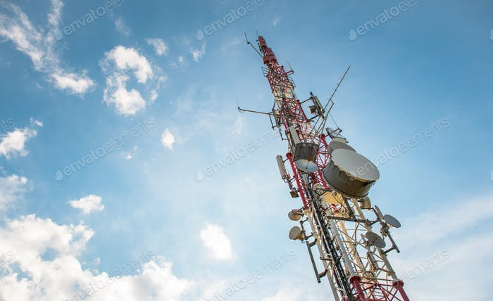 Low angle view of Antenna tower against a blue sky. 5g network cell tower.