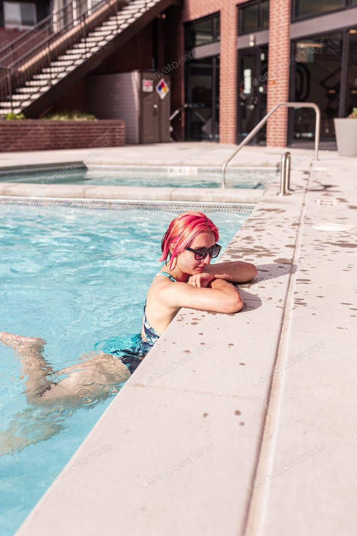 Young woman is swimming in pool