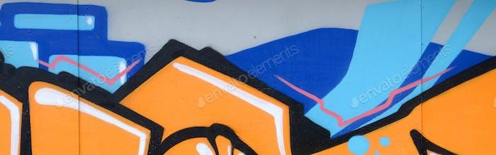 Fragmento de pinturas de graffiti de arte callejero de colores con contornos y sombreado de cerca