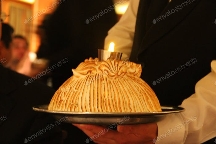 Baked Alaska is being served at the special formal romantic candle light dinner.