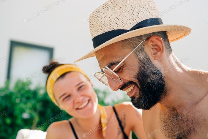 couple on vacation laughing