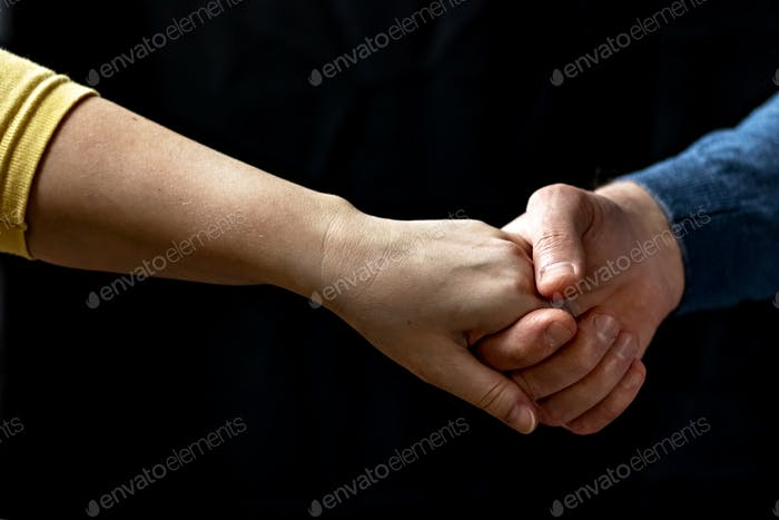 Young couple holding hands showing love and care, husband and wife are tenderly close together