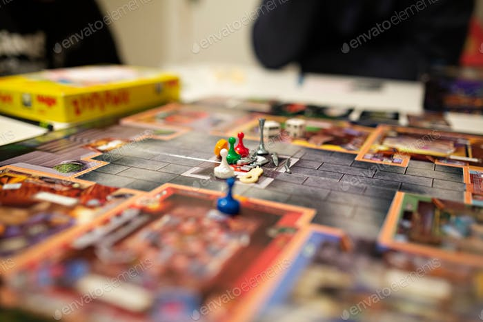 family plays the board game of clue