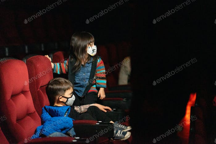 Kids watching movie with a mask