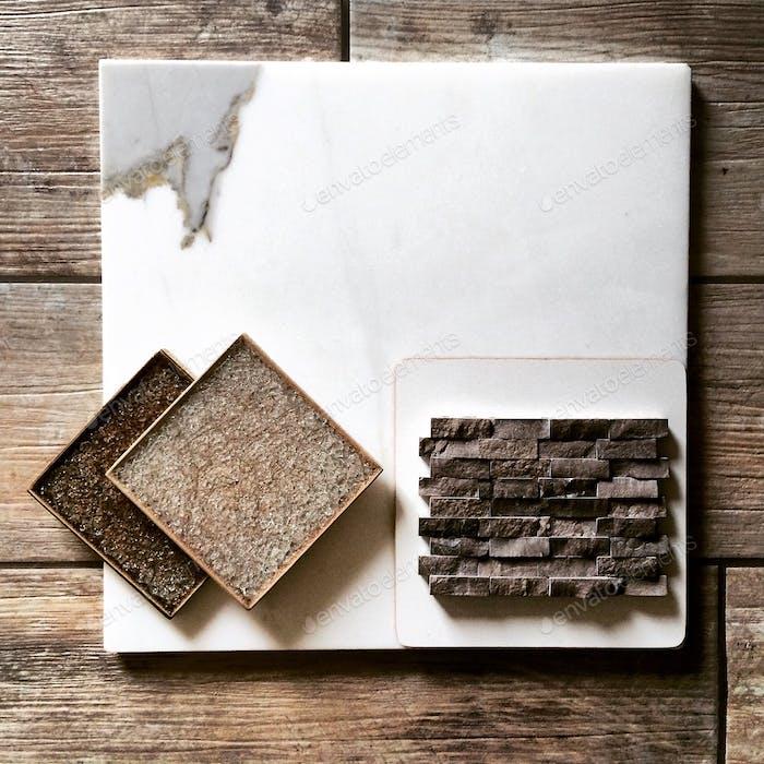 Tile: porcelain wood-plank, Calcutta marble, crackle-glass 4x4, and split-face mosaic.
