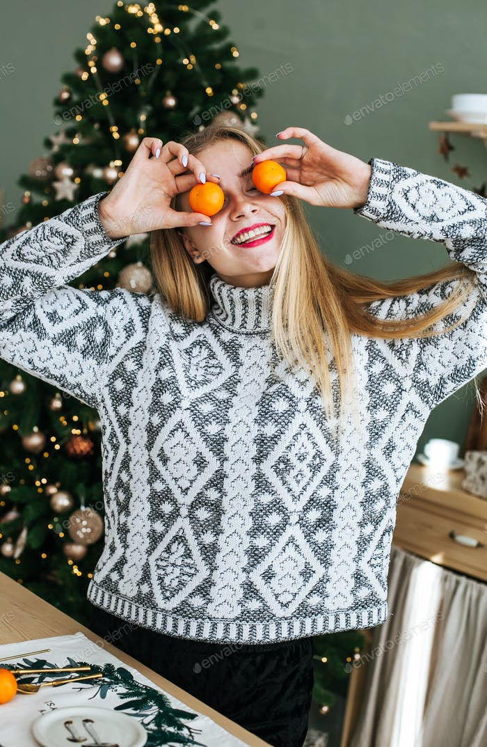 Beautiful woman in cozy Christmas atmosphere stock photo