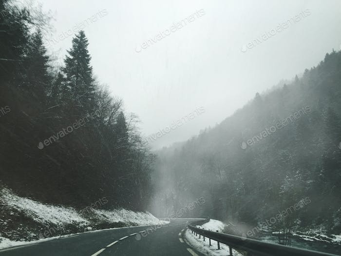Foggy Mountain Road & River With Snow