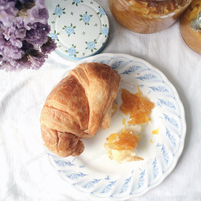 Homemade marmalade with croissant.
