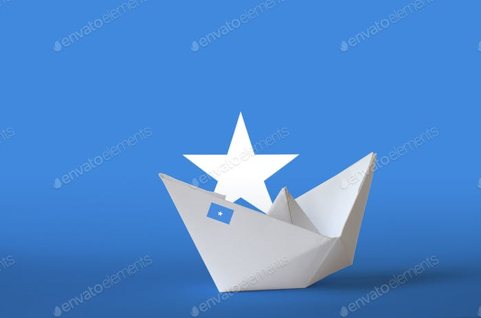 Somalia flag depicted on paper origami ship closeup. Oriental handmade arts concept