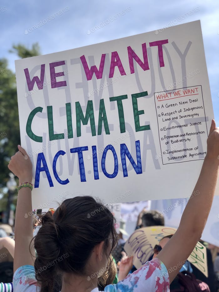 Young woman holding Climate change protest sign