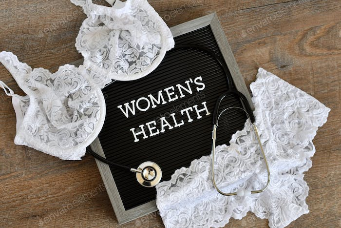 Women's Health message board sign with a stethoscope and white lace bra and panties.