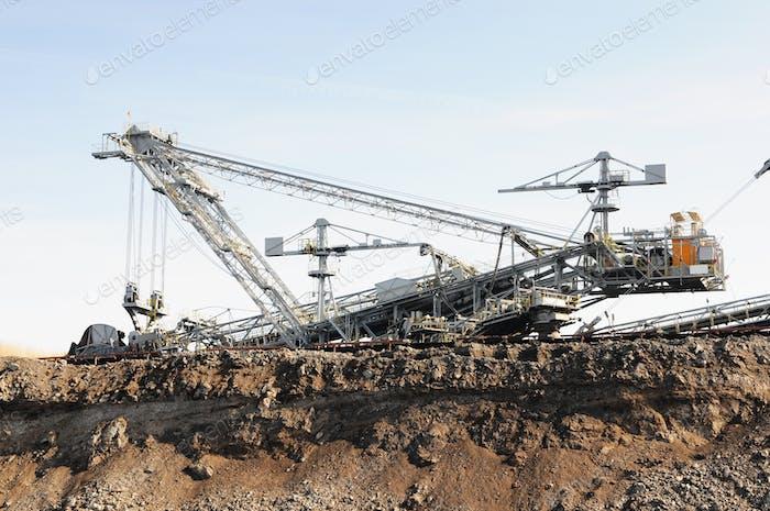coal mine with a Bucket-wheel excavator. Fossil flues