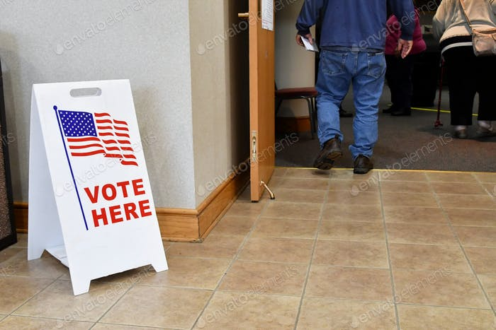 People walking into a polling place on Election Day