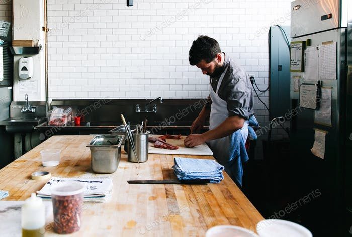 Prepping for dinner service, Olympia Provisions