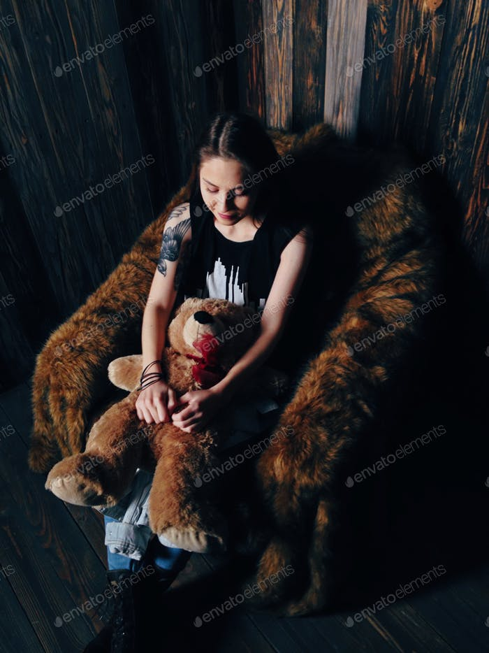 Portrait of a brunette with bear