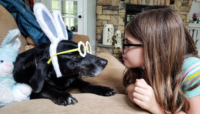 Little girl is communicating with the Easter dog in a language no one else understands....