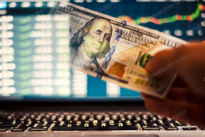 Investing money into stock market investing computer screen