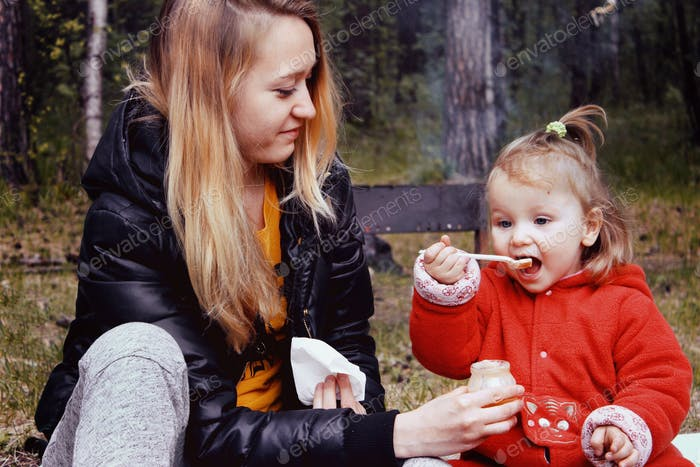 camping with a child / feeding a child / childhood memories/ baby girl with mother