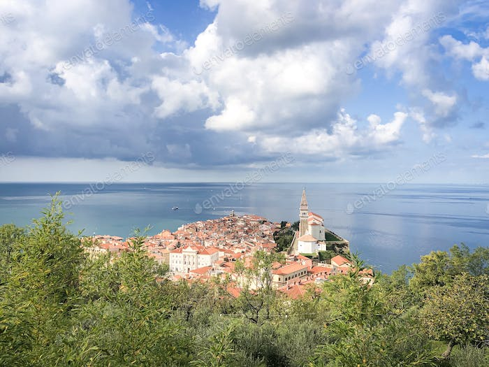 Old town of Piran with orange roofs by Adriatic sea in Slovenia