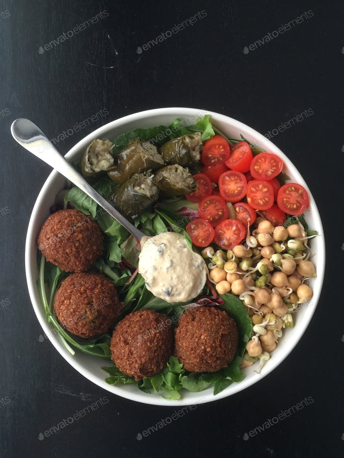 Salad game strong: falafel + stuffed grape leaves + Kalamata olive hummus + sprouted chickpeas
