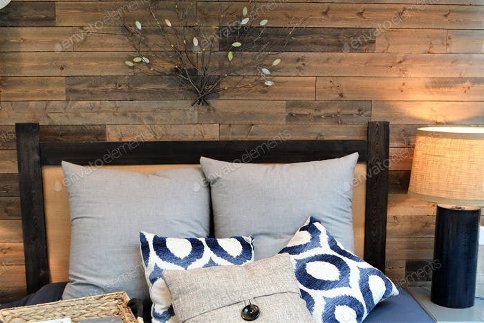 Home sweet home bedroom with reclaimed wood wall