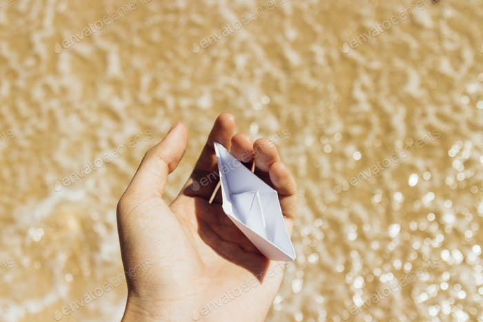 Boat origami at the beach