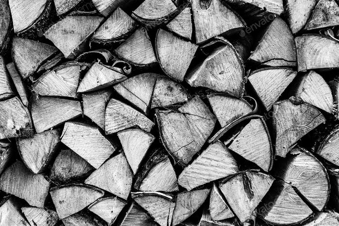 stacked firewood from chopped wood in a woodpile as a textured background. birch wood texture