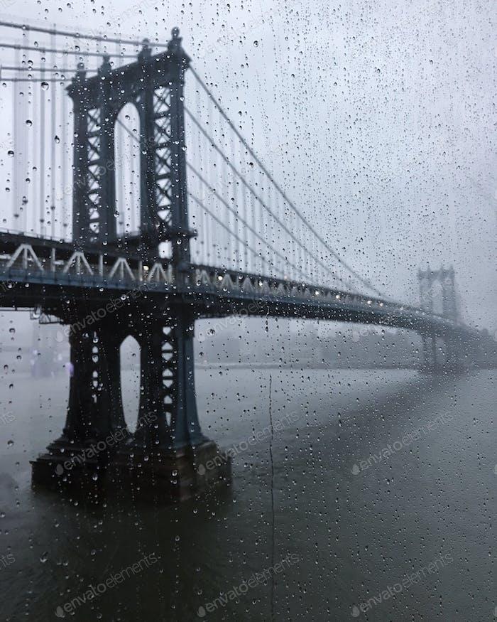 Manhattan Bridge on rainy day.  Rain Droplets  Rain drops Stormy weather  Winter