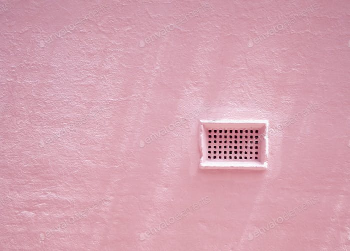 Pink wall with brick air vent