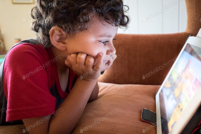 Preschooler watching a show on a tablet