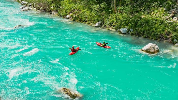 Two kayaks on an emerald river. Adrenaline, outdoor activity, sport, recreation, kayaking.
