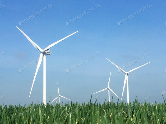 Wind turbines on a windfarm generating clean renewable electricity in a rural environment