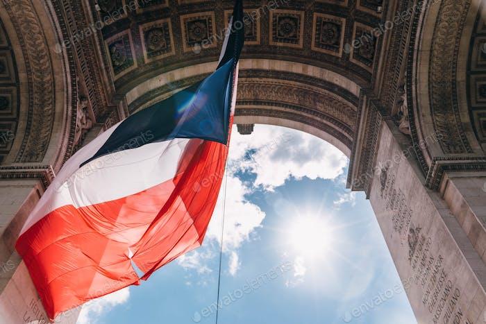 Paris flag and arc de triomphe