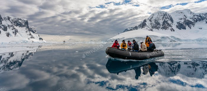Adventure tourists in Pleneau Bay in the Lamaire Channel in Antarctica.