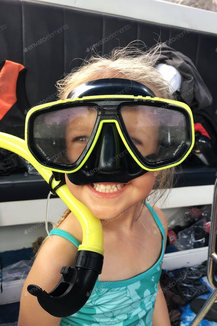⭐️⭐️⭐️ Nominated ⭐️⭐️⭐️   little girl in a swimsuit and a mask for scuba diving