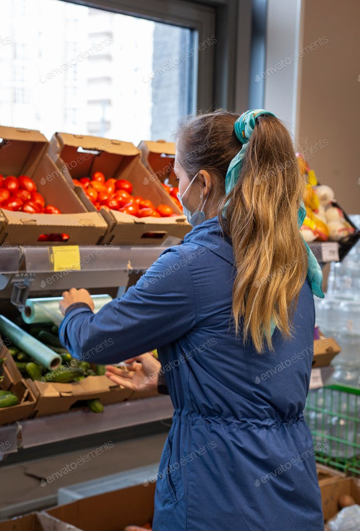 young woman of european appearance shopping in the supermarket