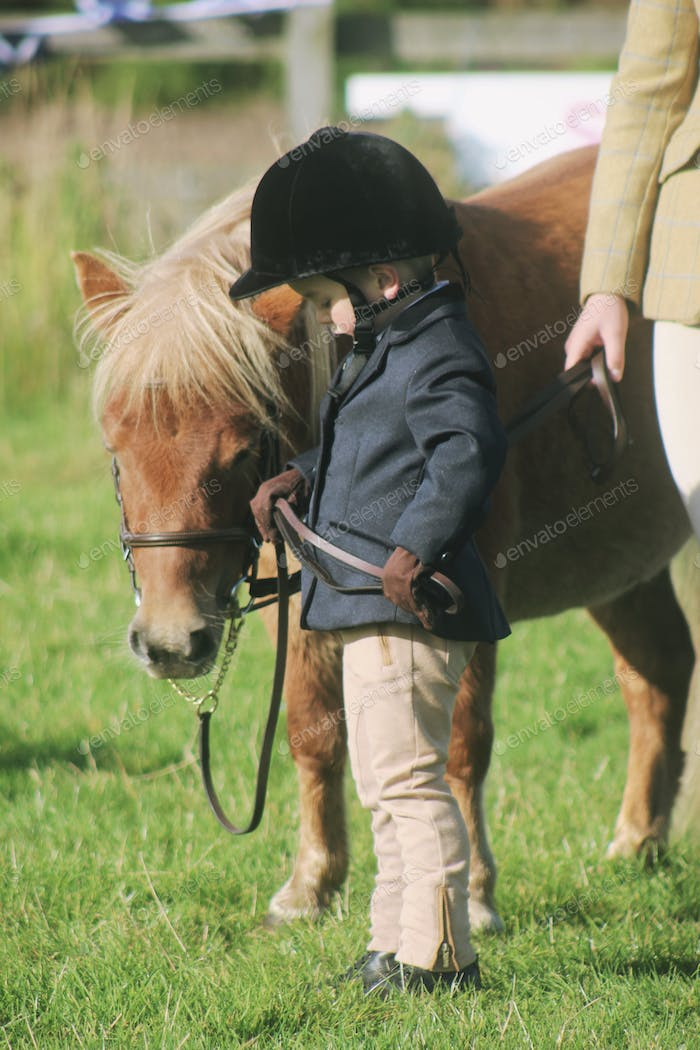 Young boy at his first horse show with his Shetland pony