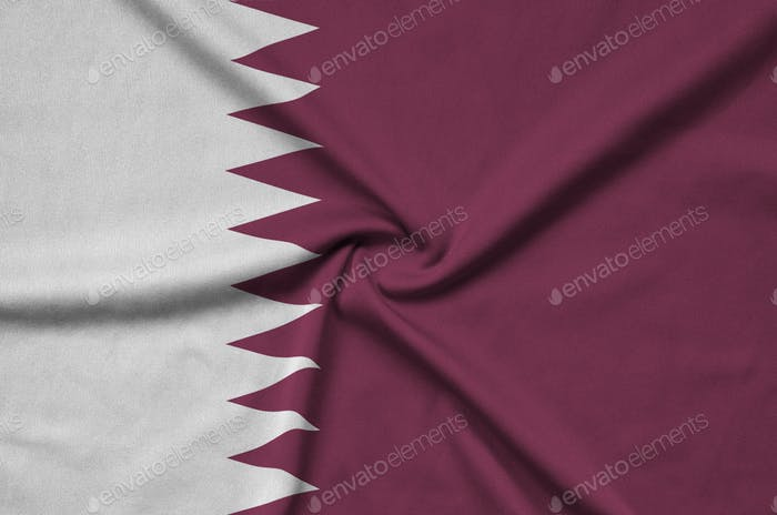 Qatar flag  is depicted on a sports cloth fabric with many folds. Sport team waving banner