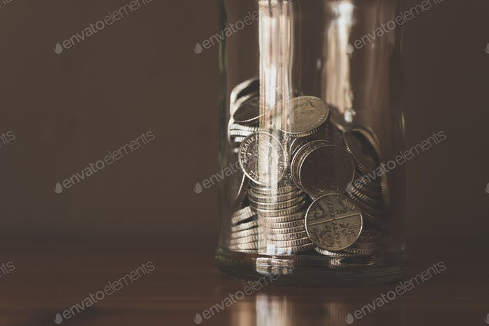 Coins in a bottle.