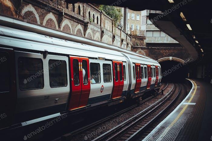 Tube, Underground, Station, Transportation,Urban Lifestyle. Red. Tunnel. Urban scene, Train, Depth.
