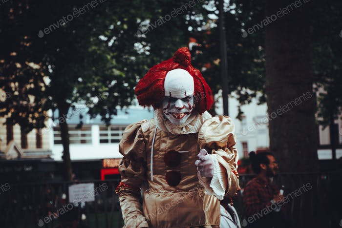 It. Costume. Clown. Close-up. Horror movie. Red color. Front view. Film. Focus on foreground.
