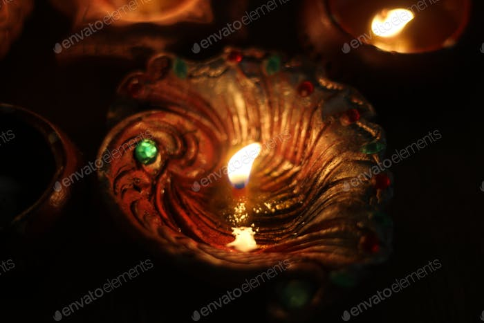 Oil lamp made from clay with a cotton wick dipped in ghee