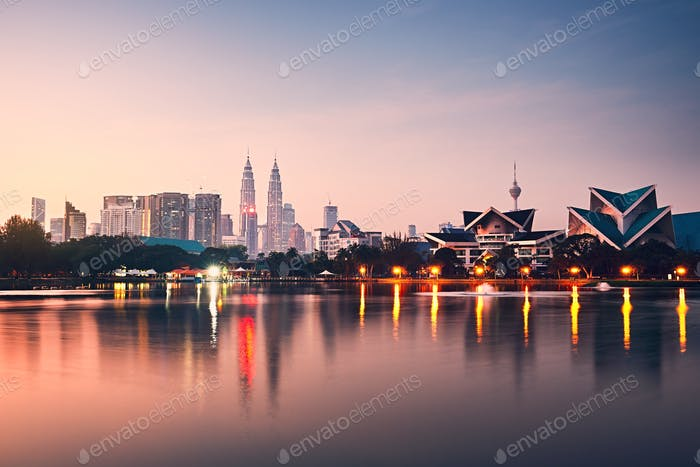 Kuala Lumpur at the sunrise and reflection of the city skyline in the lake, Malaysia