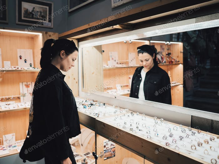 Young girl in retail jewelry store